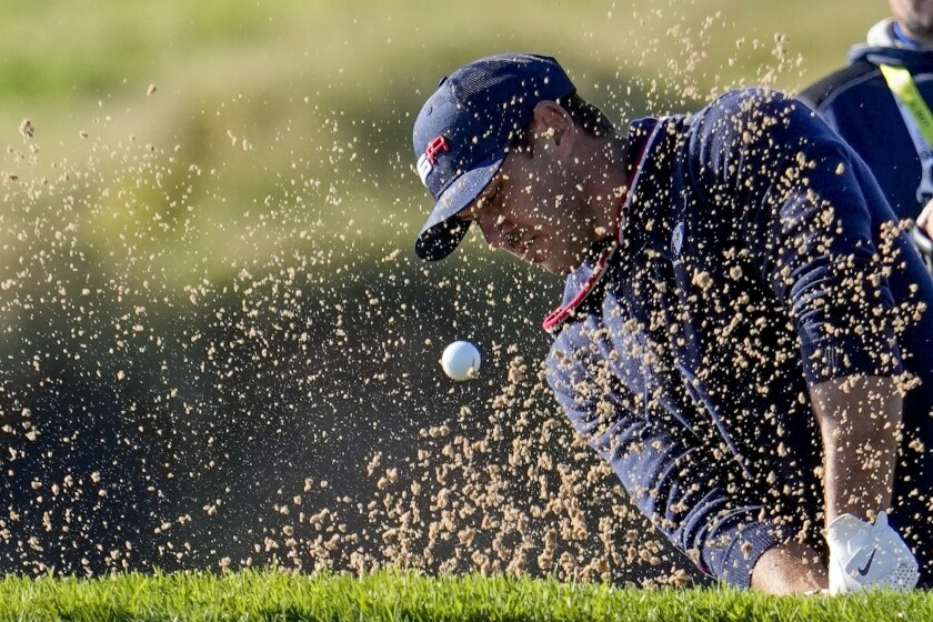 Team USA's Brooks Koepka hits from a bunker on the eighth hole during a foursomes match the Ryder Cup at the Whistling Straits Golf Course Saturday, Sept. 25, 2021, in Sheboygan, Wis. (AP Photo/Jeff Roberson)