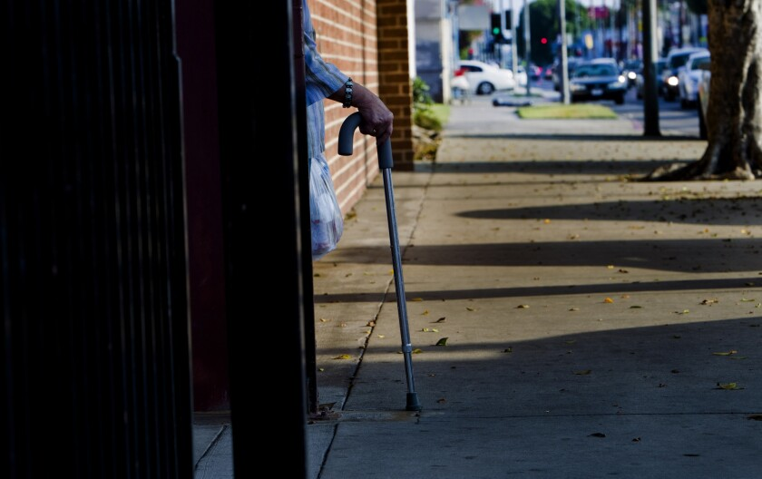 A patient is seen leaving T.H.E. Clinic in south Los Angeles. According to the California Healthcare Foundation, more than 7 million Californians, or 22% of the state's residents, were uninsured in 2011.