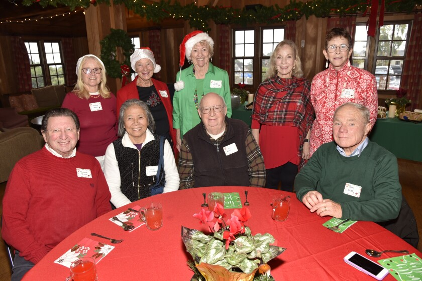 Holiday luncheon committee member/Founding DMCC member Nancy Weare, committee members Barbara Paulovich and Fran Banker, Barbara Healy, Carol Poole. Seated: Thomas Greco, Nancy and Alan Marchand, John Healy