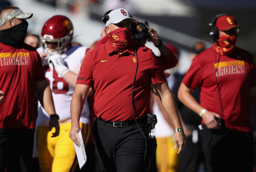 USC coach Clay Helton watches on the sideline during a game against Arizona.
