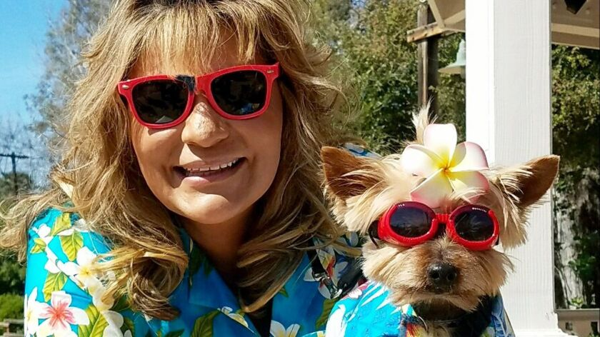 Mary Caraway of Poway and Bailey the Yorkie were the winners of the owner-and-dog lookalike contest