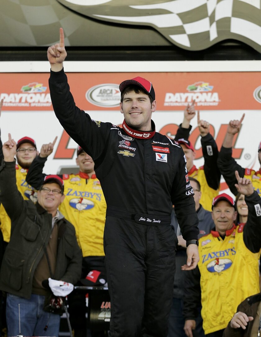 John Wes Townley celebrates after winning the ARCA series auto race at Daytona International Speedway, Saturday, Feb. 13, 2016, in Daytona Beach, Fla. (AP Photo/Terry Renna)
