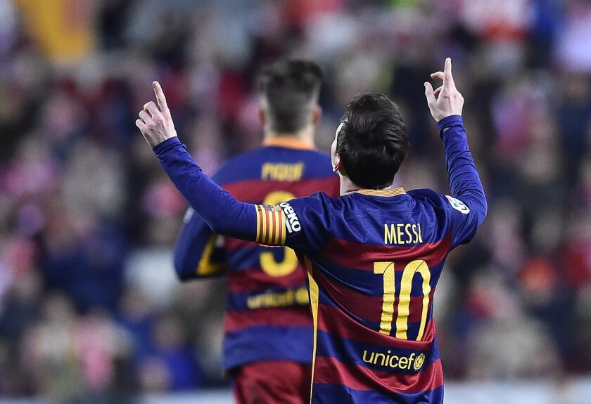 FC Barcelona's Lionel Messi, celebrates after scoring a goal during their Spanish La Liga soccer match between Sporting de Gijon and FC Barcelona at El Molinon stadium, in Gijon, northern Spain, Wednesday, Feb.17, 2016. (AP Photo/Alvaro Barrientos)