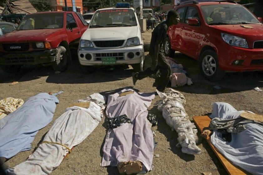 Bodies are left in the street in Port-au-Prince, Haiti, for lack of transportation or government services.