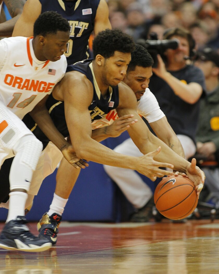 Pittsburgh's Derrick Randall, center, and Syracuse's Kaleb Joseph, left, and Michael Gbinije, right, dive for a loose ball in the first half of an NCAA college basketball game in Syracuse, N.Y., Saturday, Feb. 21, 2015. (AP Photo/Nick Lisi)