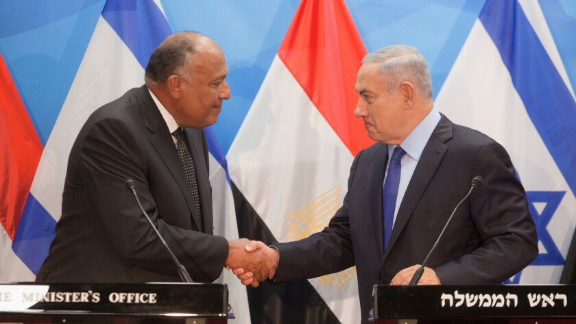 Israeli Prime Minister Benjamin Netanyahu, right, shakes hands with Egyptian Foreign Minister Sameh Shoukry in Jerusalem on July 10, 2016.
