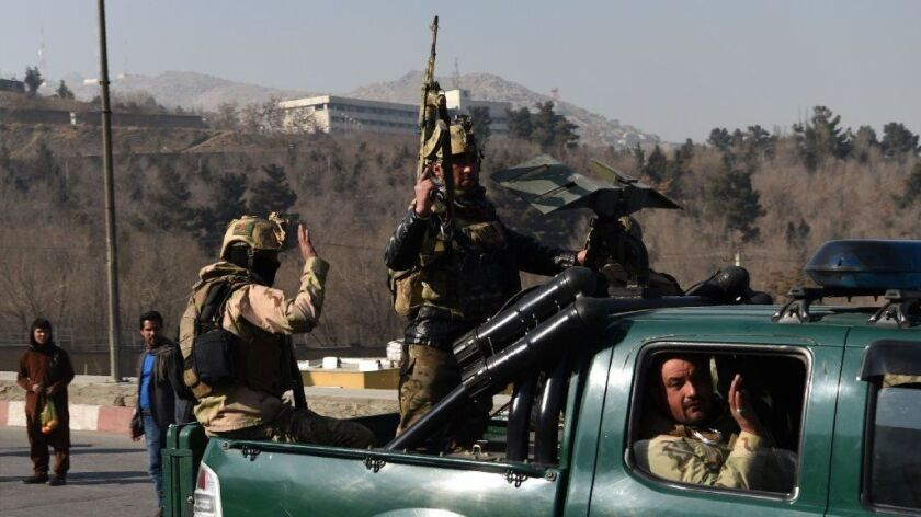 Afghan security personnel leave the Intercontinental Hotel after an attack in Kabul on Jan. 21.