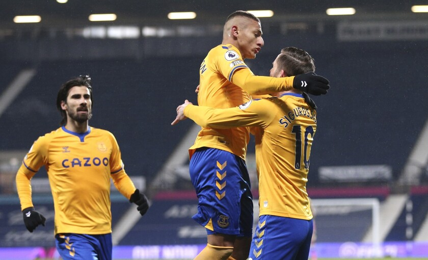 Everton's Richarlison, centre, celebrates after scoring his side's opening goal during the English Premier League soccer match between West Bromwich Albion and Everton at the Hawthorns, West Bromwich, England, Thursday, March 4, 2021. (Alex Pantling/Pool via AP)