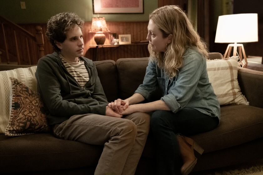 In the movie, Ben Platt and Julianne Moore sit on a couch having a heart-to-heart.