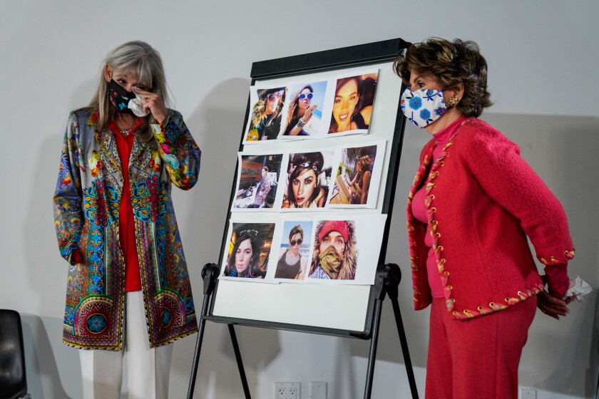 Janet Baggett and Gloria Allred stand alongside photos of the late Elizabeth Baggett.