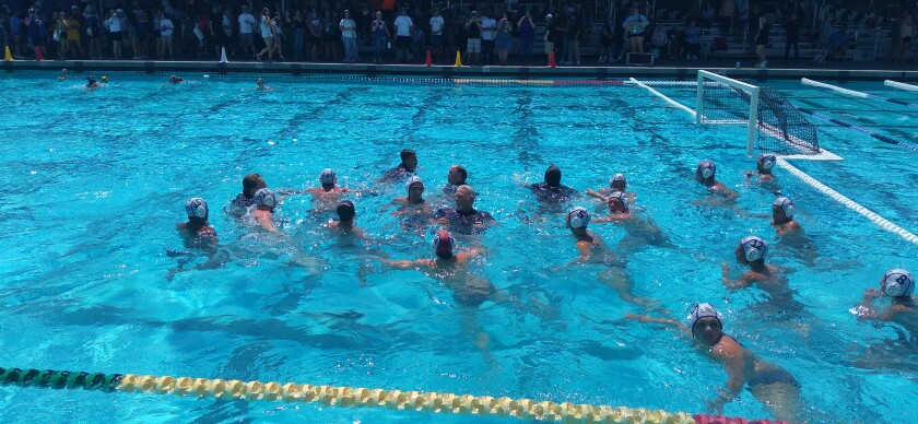The Santana boys water polo team celebrates school's first title in the sport after tossing coach Rob Bowen into the pool.