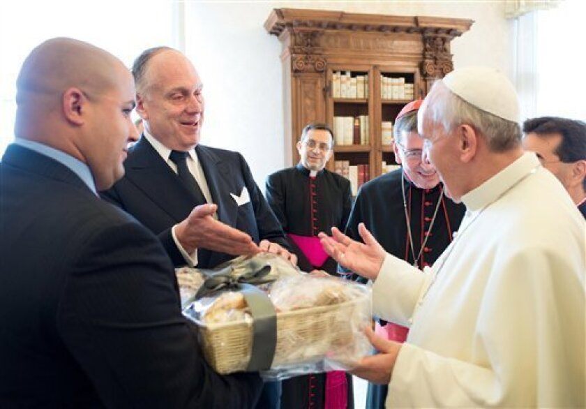 In this photo provided by the Vatican newspaper L'Osservatore Romano, Pope Francis receives a gift from the President of the World Jewish Congress Ronald S.Lauder, second from left, on the occasion of the pontiff's private audience with a delegation of the WJC, at the Vatican, Monday, Sept. 2, 2013. (AP Photo/L'Osservatore Romano, ho)