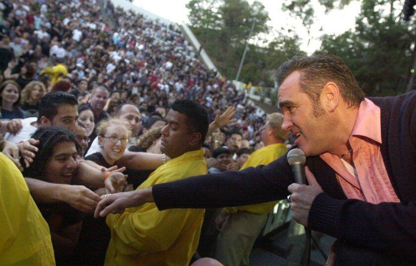 British rocker Morrisey reaches out to fans during concert at SDSU's Open Air Theatre.