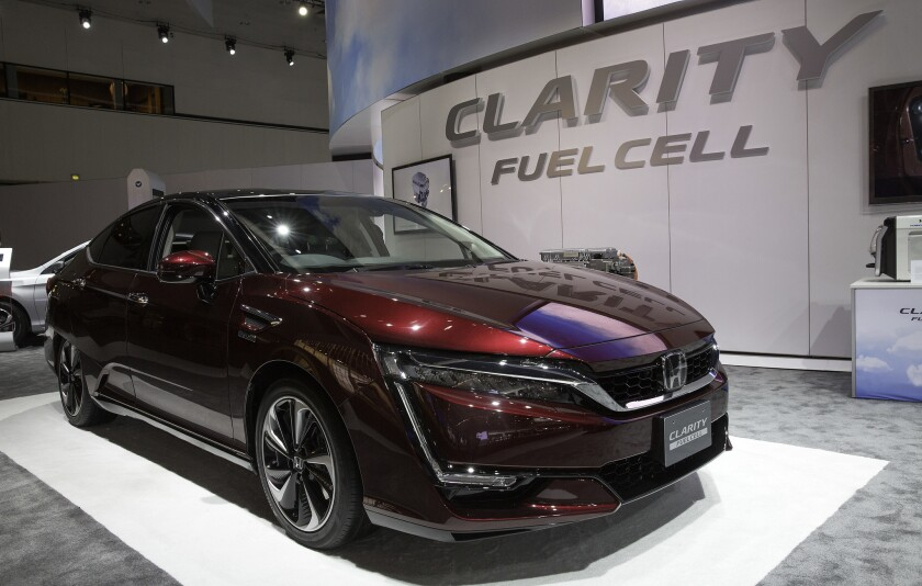 The Honda Clarity fuel cell vehicle, seen here at the 2015 Los Angeles Auto Show, is being priced to compete with Toyota's fuel cell Mirai vehicle.
