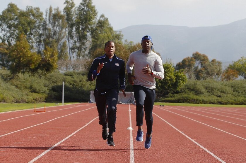 Guide runner Jerome Avery and Paralympic sprinter David Brown trains at the Chula Vista Eite Athlete Center