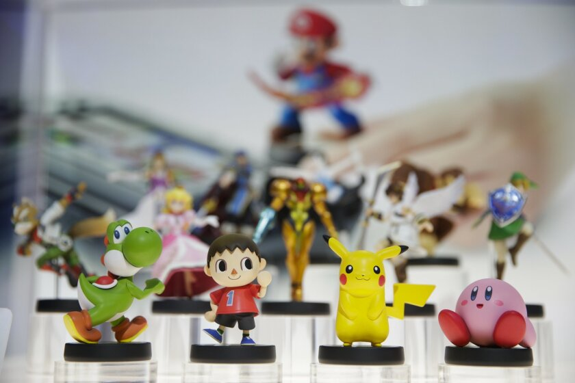 Amiibo characters for Wii U are on display at the Nintendo booth during the Electronic Entertainment Expo on Tuesday, June 10, 2014, in Los Angeles. (AP Photo/Jae C. Hong)