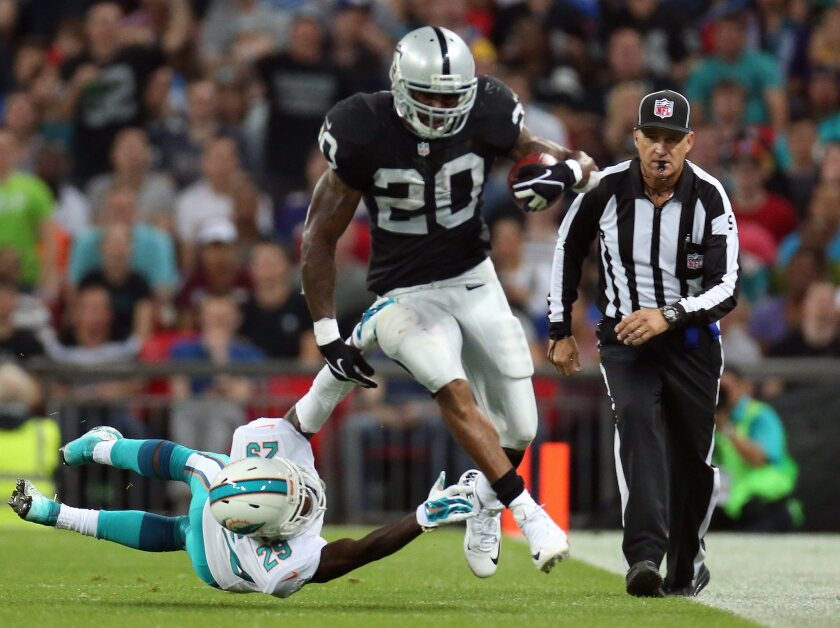The Oakland Raiders' Darren McFadden gets tackled during Sunday's game against the Miami Dolphins in London.