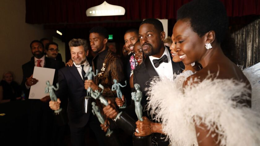 """Black Panther"" cast members Andy Serkis, Chadwick Boseman, Michael B. Jordan, Lupita Nyong'o, Sterling K. Brown, Angela Bassett, and Danai Gurira celebrate backstage at the 25th Screen Actors Guild Awards."