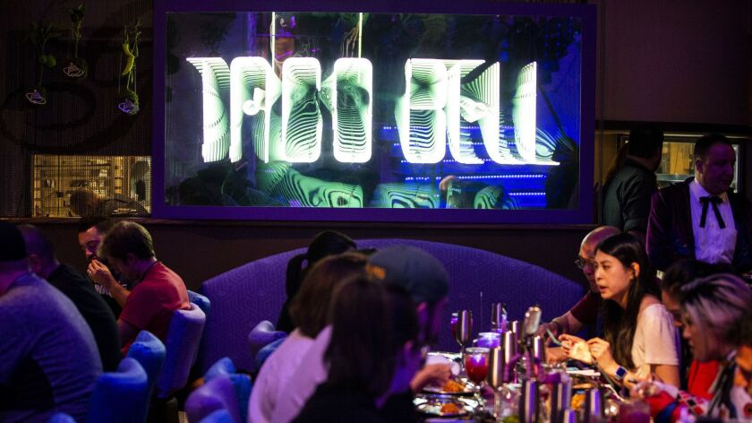 SAN DEIGO, CALIF. - JULY 19: A futuristic Taco Bell sign hangs in the dining room at the Demolition