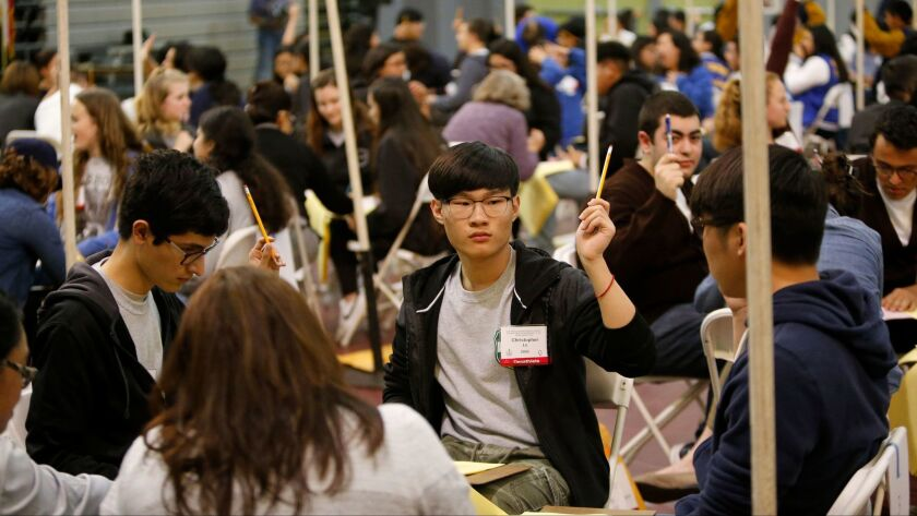 The team from Granada Hills Charter High School competes in the Super Quiz during the L.A. Unified academic decathlon in February in L.A. (Allen J. Schaben / Los Angeles Times)