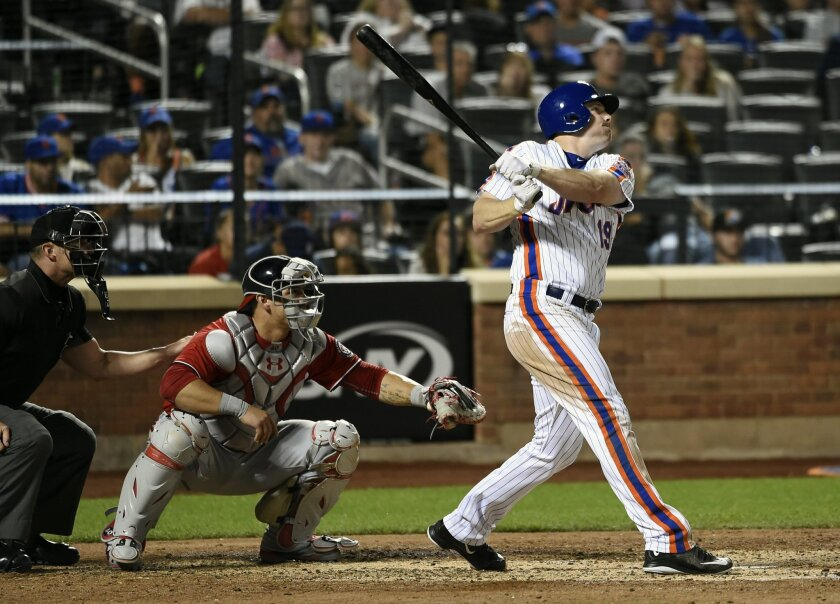 New York Mets Jay Bruce hits a two-run home run as Wilson Ramos catches for the Washington Nationals in the sixth inning of a baseball game, Sunday, Sept. 4, 2016, in New York. (AP Photo/Kathy Kmonicek)
