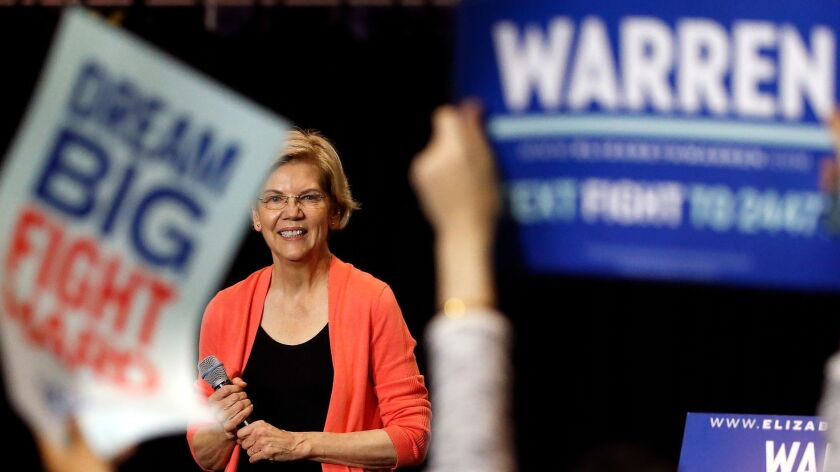 Massachusetts Sen. Elizabeth Warren speaks at a town hall in Miami on June 25, 2019, the night before the first Democratic presidential debate of the 2020 campaign.
