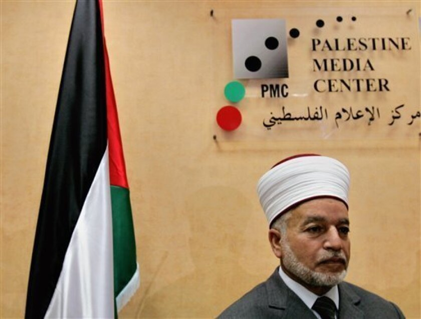 FILE - In this Sept. 19, 2006 file photo, Mufti of Jerusalem, Mohammed Hussein, pauses during a media conference in the West Bank town of Ramallah. Israeli police detained Mufti Hussein, a top cleric in the Palestinian territories, and are questioning him over his role in disturbances at a holy Jerusalem shrine Tuesday, May 7, 2013. (AP Photo/Muhammed Muheisen, File)