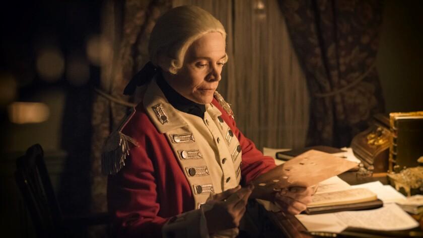 "Major Edmund Hewlett (Burn Gorman) encrypts a message intended for British Intelligence on the Season 2 finale of ""TURN: Washington's Spies."""
