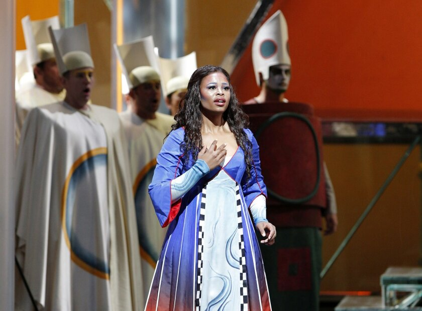 "In this Oct. 2, 2014 photo released by the Metropolitan Opera South African soprano Pretty Yende appears during a rehearsal of Mozart's ""Die Zauberfloete"" (""The Magic Flute"") in New York. Yende, 29, is returning for a second engagement at the Met, singing four performances as Pamina in Mozart's ""The Magic Flute"" beginning Monday, Oct. 6. (AP Photo/Metropolitan Opera, Marty Sohl)"