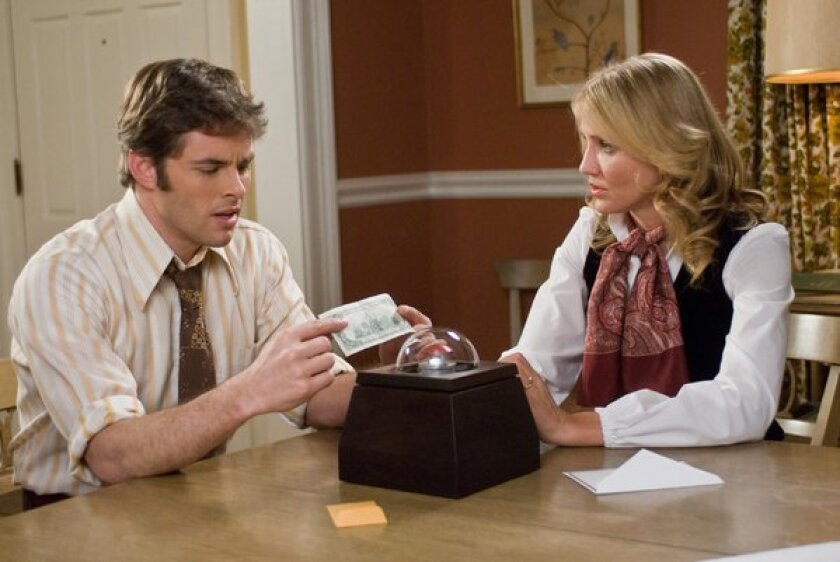 """James Marsden and Cameron Diaz in Richard Kelly's """"The Box,"""" based on the short story """"Button, Button"""" by Richard Matheson."""