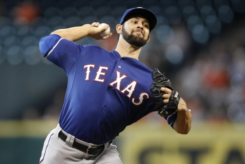Texas Rangers Nick Martinez throws during the second inning of a baseball game against the Houston Astros, Sunday, Aug. 31, 2014, in Houston. (AP Photo/Patric Schneider)