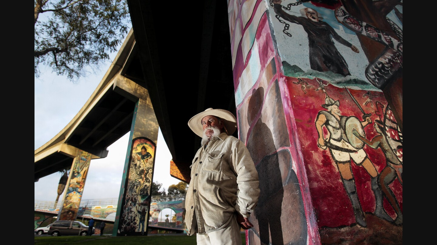 Chicano Park regular Antonio Chavez leans against one of several San Diego-Coronado Bridge supports that are covered with murals.