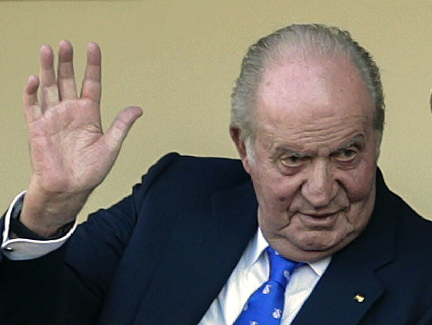 FILE - In this file photo dated Sunday, June 2, 2019, Spain's former King Juan Carlos waves at the bullring in Aranjuez, Spain. The former lover of Spain's King Emeritus Juan Carlos has filed a lawsuit with a British court accusing him of spying on her, the public relations firm representing Corinna Larsen confirmed Wednesday July 28, 2021. (AP Photo/Andrea Comas, FILE)