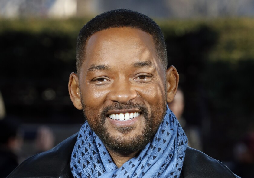 """FILE - In this Monday, Jan. 6, 2020, file photo, U.S actor Will Smith poses for photographers during the photo call of """"Bad Boys for Life,"""" in Paris. Smith is ready to open up about his life story. Penguin Press announced Sunday, June 20, 2021, that Smith will release his memoir called """"Will"""" on Nov. 9. The actor-rapper shared a photo of the book's cover art to more than 54 million followers on Instagram. Smith said he is """"finally ready"""" to release his memoir after working on his book for the past two years. (AP Photo/Thibault Camus, File)"""