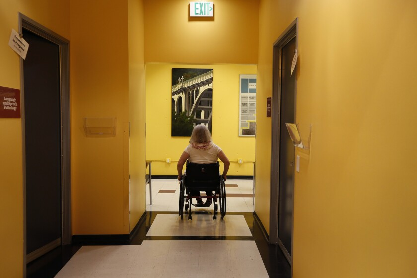 Following the first half of her physical therapy appointment, Missy Morris moves through Huntington Hospital's Rehabilitation Center in Pasadena.