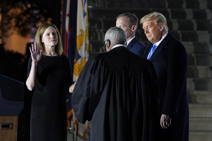 Amy Coney Barrett takes the oath to join the Supreme Court.