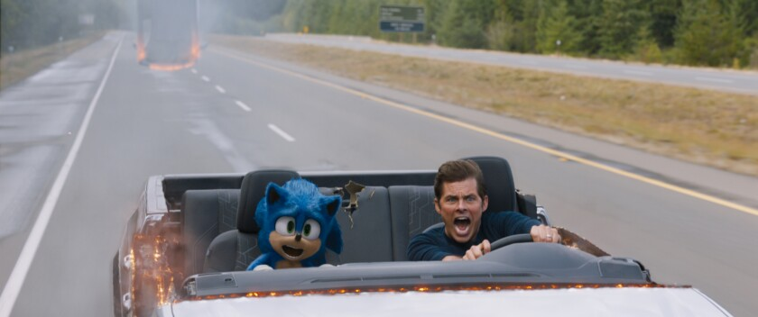 "Sonic (voiced by Ben Schwartz) and James Marsden in the movie ""Sonic the Hedgehog."""