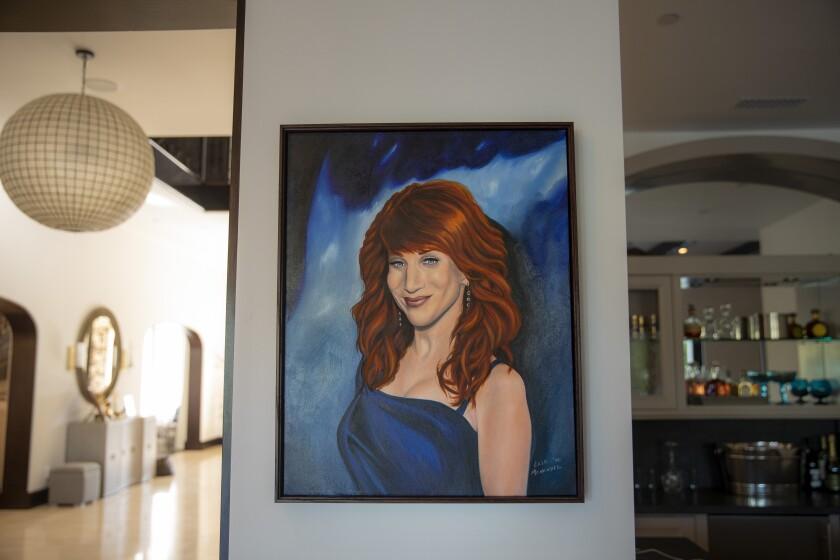 """A portrait of Kathy Griffin painted in prison by convicted murderer Erik Menendez hangs in the comedian's Los Angeles home. """"He is a fan,"""" says Griffin."""