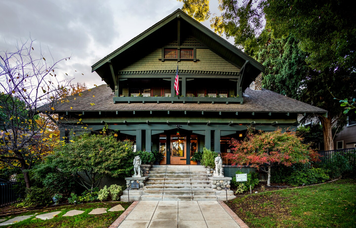 Built in 1909, the Swiss Chalet-style Craftsman is distinguished by its squarish design and a low-pitched, gabled roof with overhanging eaves. A sleeping porch sits above the covered front porch. Original details include Oregon pine woodwork, a brick living room fireplace and fixtures. Another holdover from the early 1900s: a hitching post out front. Listed for $1.2 million, the landmark residence has been updated while maintaining its classic details. Of note is the modernized main kitchen and a prep's kitchen that was installed in the garage. The basement has been reimagined as a secret bar.