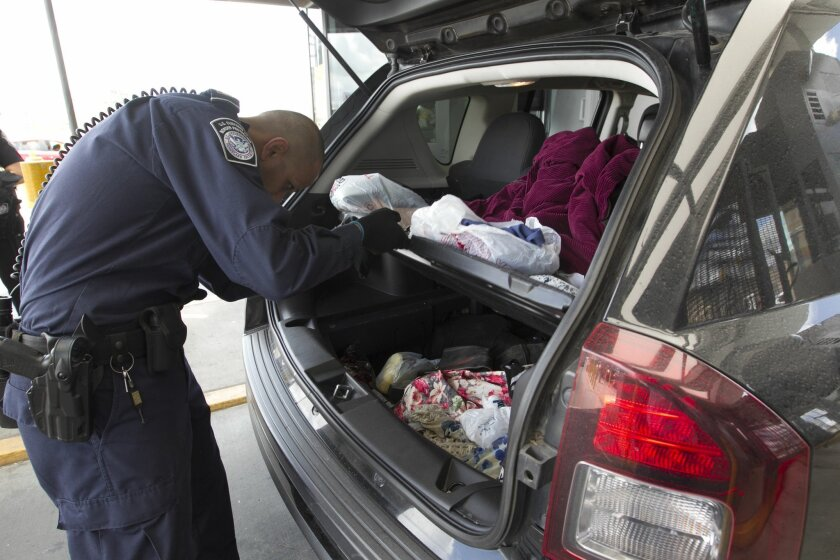 A U.S. Customs and Border Protection officer inspected a car at the inspection booth of the San Ysidro Port of Entry, the busiest in the Western Hemisphere.