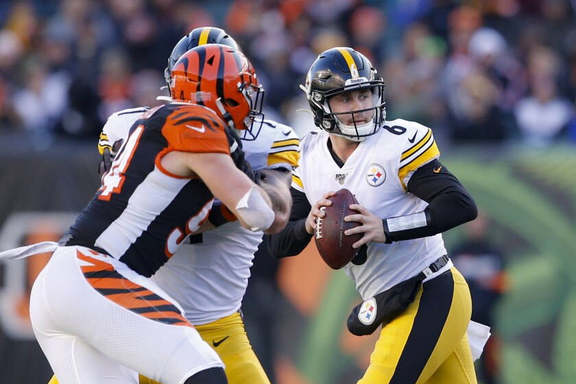 Pittsburgh Steelers quarterback Devlin Hodges looks to pass.