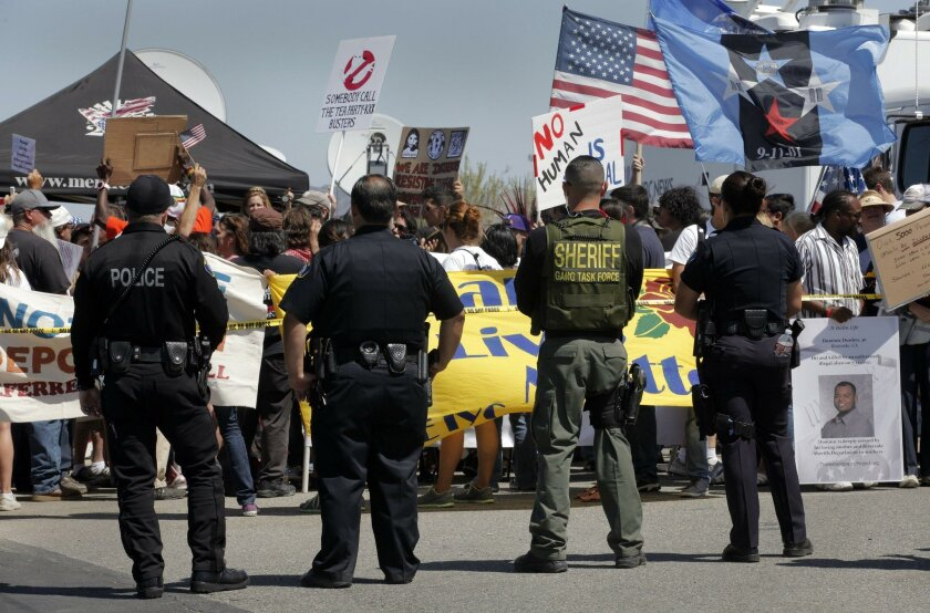 On the Fourth of July in 2014, protestors on both side of the migration issue rallied in front of the Murrieta Border Patrol headquarters in case new busloads of migrant children arrived again. About 100 people stood behind a tape away from the entrance to the station, most of them supporters of ca
