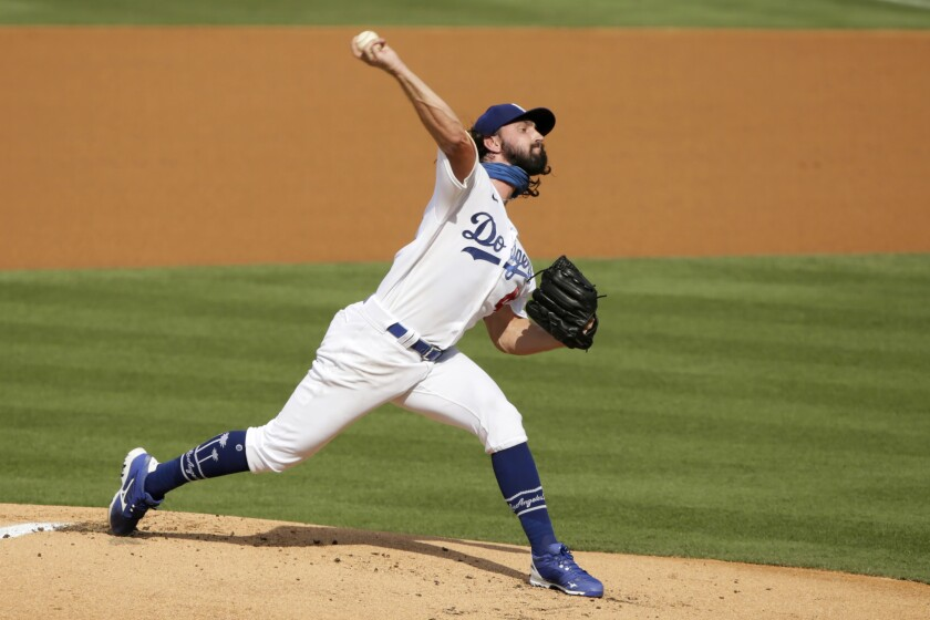 Dodgers pitcher Tony Gonsolin throws to the Seattle Mariners during the first inning at Dodger Stadium.