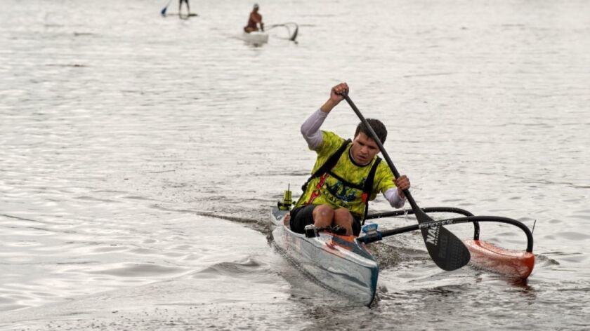 Andrew Skvarla paddles the boat during the race. photo: Steve Zylius/UCI
