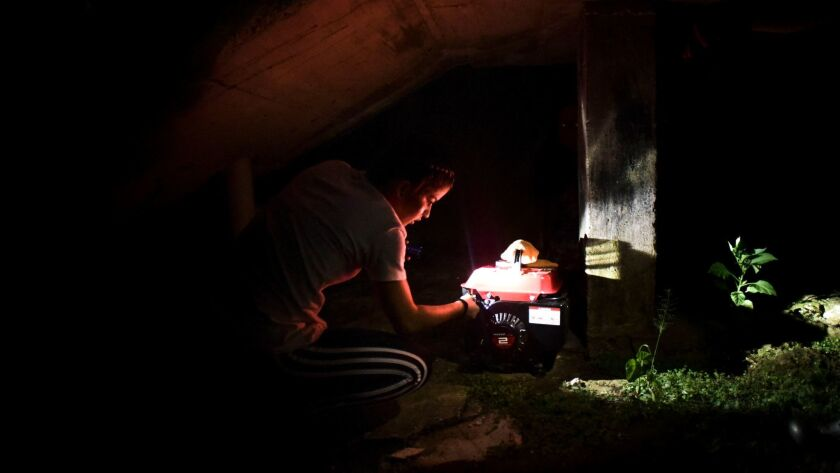 FILE - In this Dec. 21, 2017 filw photo, barrio Patron resident Karina Santiago Gonzalez works on a