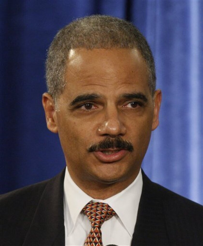 Attorney General-designate Eric Holder speaks duringa news conference with President-elect Barack Obama, not pictured, in Chicago, Monday, Dec. 1, 2008. (AP Photo/Charles Dharapak)