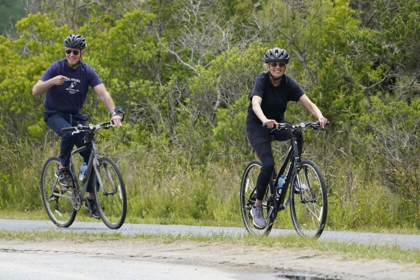 President Joe Biden and first lady Jill Biden take a bike ride in Rehoboth Beach, Del., Thursday, June 3, 2021. The Biden's are spending a few days in Rehoboth Beach to celebrate first lady Jill Biden's 70th birthday. (AP Photo/Susan Walsh)