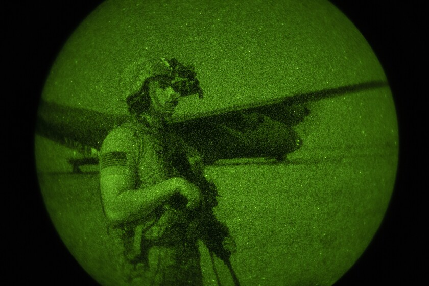 Army Spc. Dominic Deitrick seen through a night-vision device during a mission in Somalia in June.