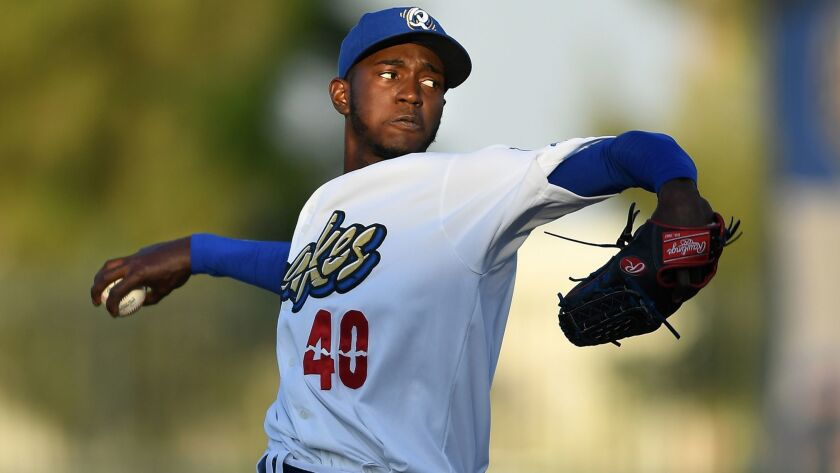 Dodgers pitching prospect Yadier Alvarez throws a pitch for Rancho Cucamonga during a game on June 5, 2017