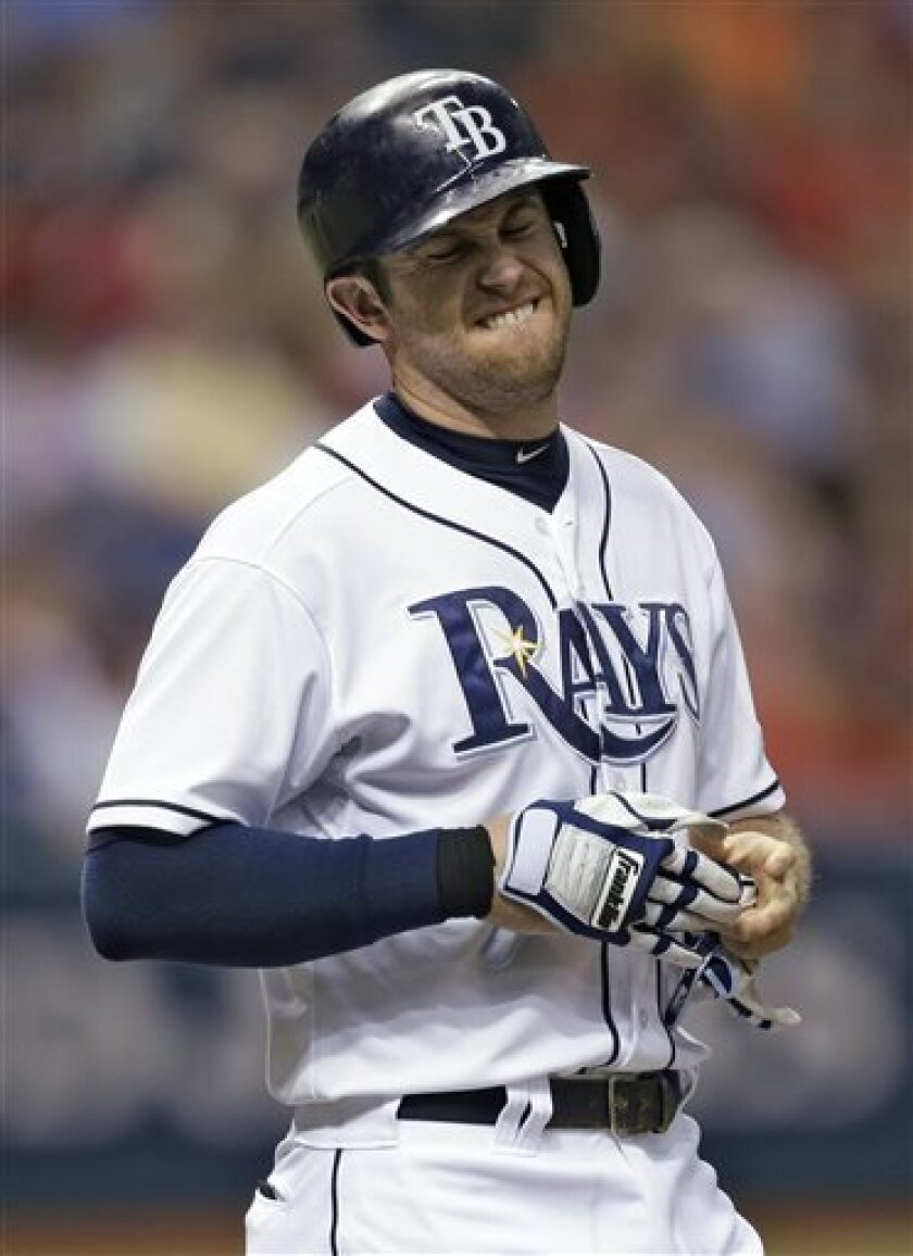 Tampa Bay Rays' Evan Longoria grimaces after getting hit with a third-inning pitch from Boston Red Sox starter Ryan Dempster during a baseball game Wednesday, Sept. 11, 2013, in St. Petersburg, Fla. (AP Photo/Chris O'Meara)